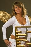 Angel with a golden abacus Stock Photography