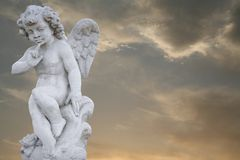 Angel with golden sky. Angel child with golden sky stock photography
