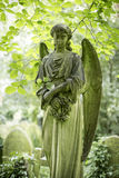 Angel Grave Sculpture in Cemetery - 3 Stock Images
