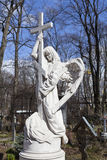Angel. Gravestones at the Smolensk cemetery. St. Petersburg. Stock Photo