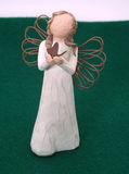Angel on green. Wooden faceless angel Royalty Free Stock Photography