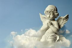 Angel guardian on the cloud. Angel guardian praying and kneeling on the cloud Stock Image