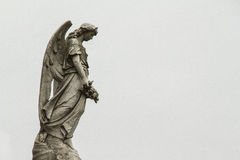 Angel guarding the graves of the dead. Royalty Free Stock Images
