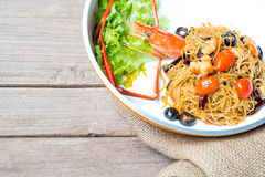 Angel hair pasta with giant prawn, olives, tomatoes, and chilli Royalty Free Stock Photos