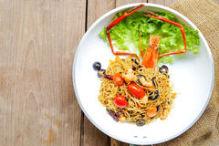 Angel hair pasta with giant prawn, olives, tomatoes, and chilli Stock Photo