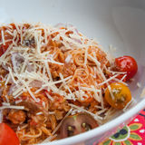 Angel Hair Pasta. Angel hair past with parmesan cheese and fresh cherry tomatoes Stock Image