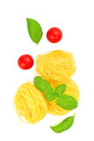 Angel Hair pasta preparation for cooking by angel hair pasta, tomatoes, basil leaves all ingredients are organics Stock Images