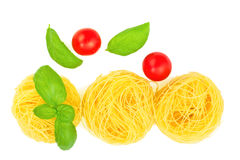 Angel Hair pasta preparation for cooking by angel hair pasta, tomatoes, basil leaves all ingredients are organics Stock Image