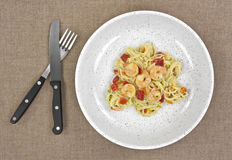 Angel hair pasta with shrimp in shallow bowl Royalty Free Stock Photo
