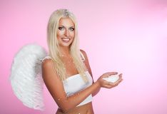 Angel with handful of snow Royalty Free Stock Images