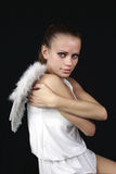 Angel hands clasped his shoulders Royalty Free Stock Photo
