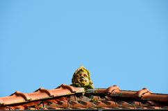 Angel head statue on roof top stock photos