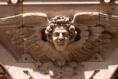 Angel head with wings above a doorway Royalty Free Stock Photos