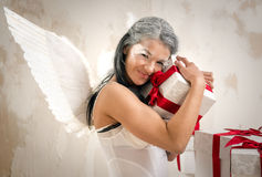 Angel with heap of gift boxes Stock Photography