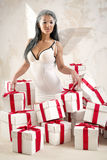 Angel with heap of gift boxes Stock Images