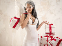 Angel with heap of gift boxes Royalty Free Stock Photos