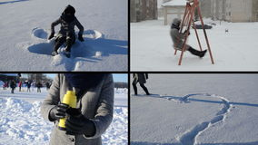 Angel and heart shape on snow. snow fall. Tea drink. Girl swing stock video footage