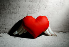 Angel heart toy. Angel heart on grunge background Royalty Free Stock Photos