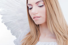 An angel from heaven. Young, wonderful blonde girl in the image of an angel with white wings. Royalty Free Stock Images