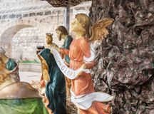 Angel hold `Gloria` banner in Nativity Scene at Nazareth stock images