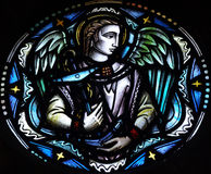 Angel holding an anchor. A stained glass photo of an angel holding an anchor Royalty Free Stock Images