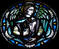 Angel holding an anchor in stained glass. A photo of an Angel holding an anchor in stained glass stock photos