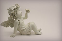 Angel holding butterfly. Figure of an angel holding butterfly Royalty Free Stock Image
