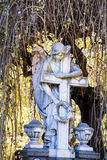 Angel holding  cross-monument Royalty Free Stock Photos