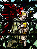 Angel holding a cup (stained glass). A photo of Angel holding a cup (stained glass stock image