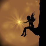 Angel holding a star Royalty Free Stock Photos