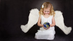 Angel holding the world in her hands Stock Image