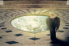 Angel at the hole of Heaven Royalty Free Stock Photo