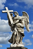 Angel with the Holy Cross and beautiful sky Royalty Free Stock Photo