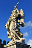 Angel with the Holy Lance of Longinus looks at the sky. Marble statue of angel holding the Holy Lance of Longinus from Sant'Angelo bridge monumental balustrade Stock Photography