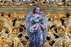 Angel on a Holy Week Float. Angel on a golden Holy Week float in Seville, Spain royalty free stock images