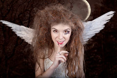 Angel with horns stock photo