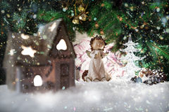 Angel in the house and Christmas tree with lights and reflections on the background of Christmas themes Royalty Free Stock Photo