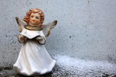 Angel and ice - Christmas background. Beautiful angel and ice in winter cemetery - Christmas background stock photos