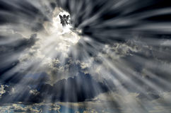 Angel In Sky Clouds With Rays Of Light