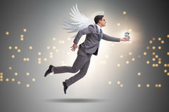 The angel investor concept with businessman with wings. Angel investor concept with businessman with wings stock images