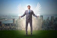 The angel investor concept with businessman with wings Royalty Free Stock Image