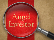Angel Investor Through a Magnifying Glass Stock Photo