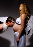 Angel kiss for pregnant belly Stock Image