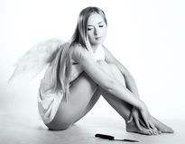 Angel with a knife Royalty Free Stock Photo