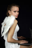 Angel with a laptop Royalty Free Stock Photos