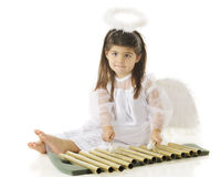 Angel Learning Chimes Royaltyfri Bild