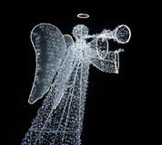 Angel of light. Luminous figure of an Angel isolated on black background Stock Photo