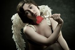 Angel with lollipop Royalty Free Stock Image