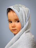 Angel look baby boy portrait. With towel on blue background Stock Photo