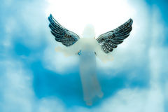 Angel looking down from heaven Stock Images